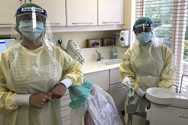 Dr Erum Khan and dental nurse in full PPE